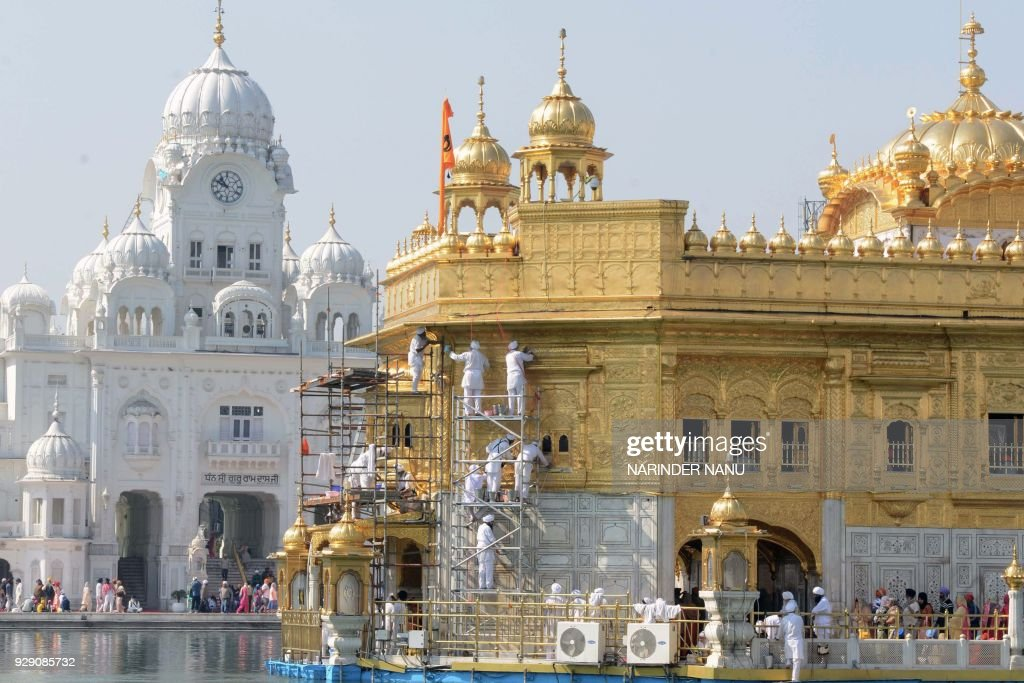 TOPSHOT Volunteers from Birmingham`s Guru Nanak Nishkam Sewak Jatha in Britain clean the gold plating of the Golden Temple Sikh Shrine in Amritsar on.
