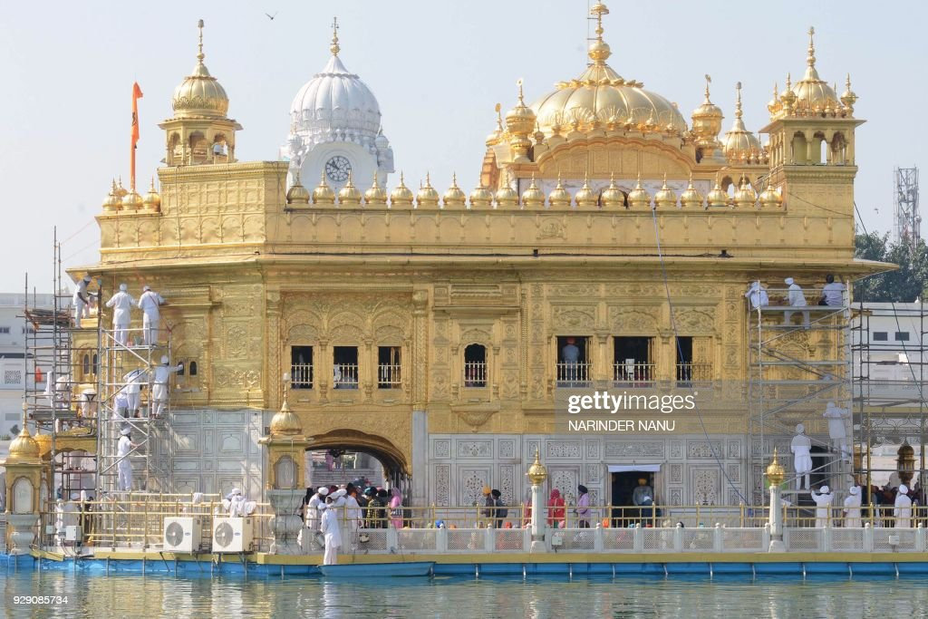 Volunteers from Birmingham`s Guru Nanak Nishkam Sewak Jatha in Britain clean the gold plating of the Golden Temple Sikh Shrine in Amritsar on March 8.