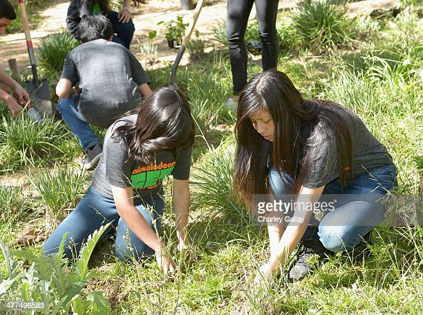 Volunteers from Buchanan Street Elementary School attend Nickelodeon Get Dirty Earth Day at Los Angeles Zoo on March 9 2014 in Los Angeles California