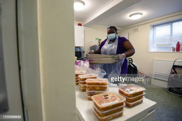 Volunteers from 'Children with Voices' community food hub prepare food parcels for vulnerable residents of Hackney at Wilton estate community Hall on...