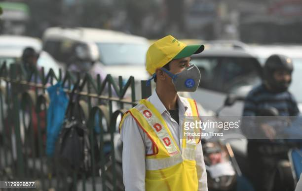 Volunteers from Civil Defence wearing anti pollution masks present on the roads to urge commuter adherence of odd-even traffic regulations, at Laxmi...