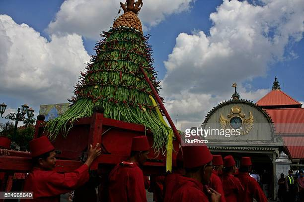 Volunteers from Kraton Palace, which is known as 'Abdi Dalem', bringing 'Gunungan' from Kraton Palace to the Grand Mosque Kauman on July 29, 2014 in...