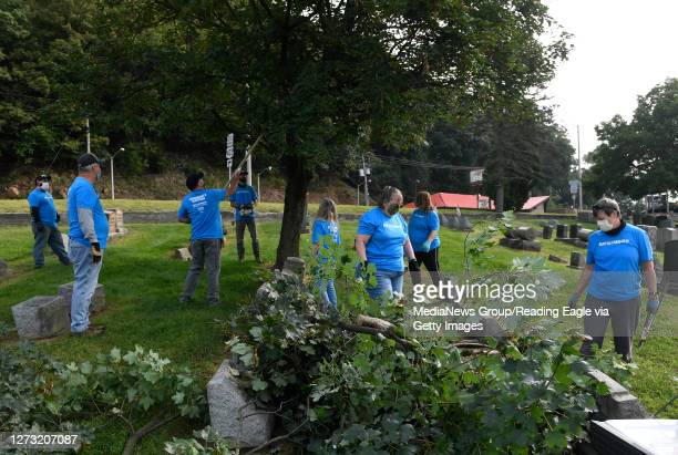 Volunteers from Met-Ed work on trimming and clearing branches from a tree. At Aulenbach Cemetery in Reading Thursday morning September 17, 2020 where...