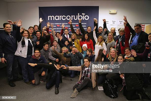 Volunteers from Miami Florida calling themselves the 305 Crew pose for a photograph with Republican presidential candidate Sen Marco Rubio and his...