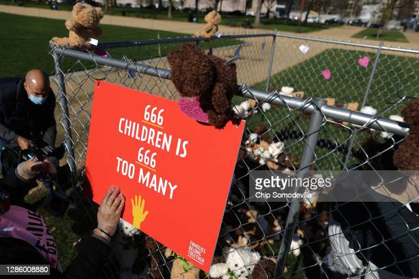 Volunteers from pro-immigration group Families Belong Together build and fill a chainlink cage with about 600 teddy bears 'representing the children...
