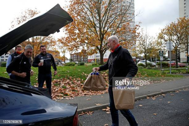 Volunteers from Richmond Rugby, prepare to deliver meals to local school children on the Ivybridge estate in Twickenham, south west London, on...