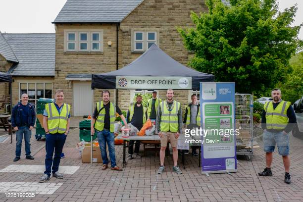 Volunteers from Saddleworth Round Table pose for a photograph as they operate a food drop to support local food banks in the civil parish of...