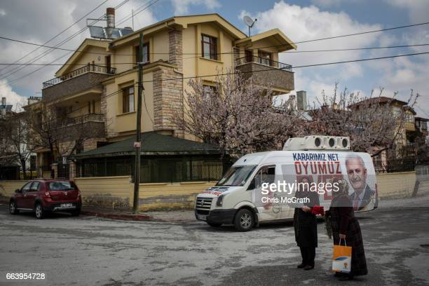 Volunteers from the AK Party campaigning for the 'Evet' vote are seen visiting houses and handing out flowerrs and campaign material on April 1 2017...