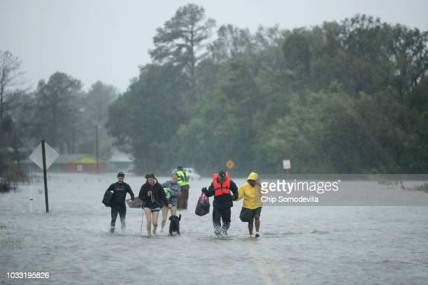 Volunteers from the Civilian Crisis Response Team help people to higher ground after rescuing them from their flooded homes during Hurricane Florence...