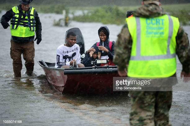Volunteers from the Civilian Crisis Response Team help rescue three children from their flooded home September 14 2018 in James City United States...