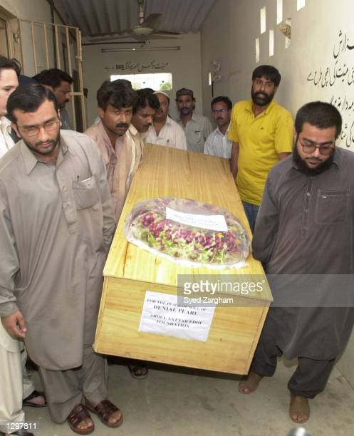 Volunteers from the Edhi Foundation, a Pakistani humanitarian organization, carry the casket containing the remains of U.S. Reporter Daniel Pearl, on...