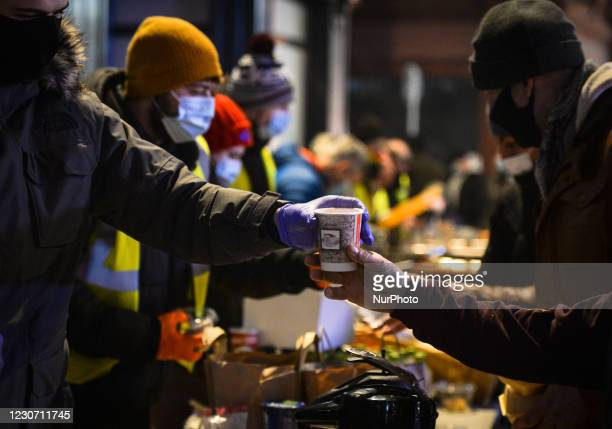 Volunteers from the Homeless Mobile Run distributing hot meals, drinks, treats, clothes and toiletries to people in need, outside Dunnes Stores on...
