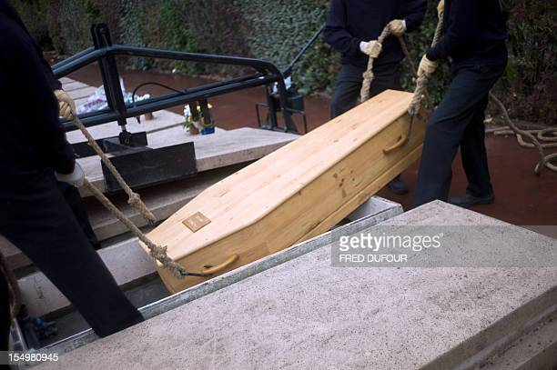 Volunteers from the humanitarian group Les morts de la rue attend on October 17 in Thiais' cemetery south of Paris a funeral ceremony dedicated to...