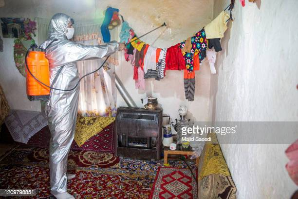 Volunteers from the Iranian Red Crescent disinfect villages on April 11 2020 near Sari Iran The Coronavirus pandemic has spread to many countries...