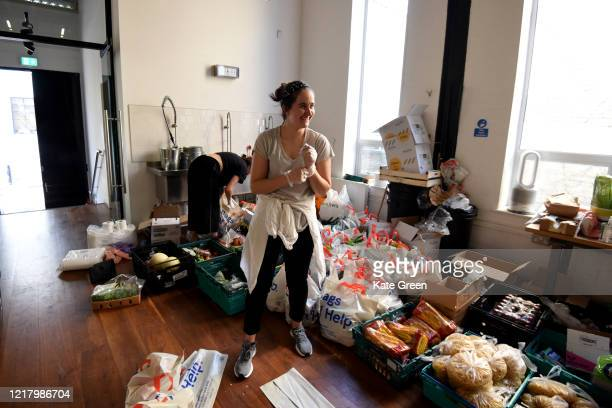 Volunteers from the Islington Covid19 Mutual Aid group preparing food parcels for a weekly distribution to members of their community who are in...