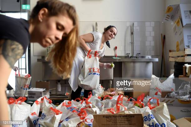 Volunteers from the Islington Covid-19 Mutual Aid group preparing food parcels for a weekly distribution to members of their community who are in...
