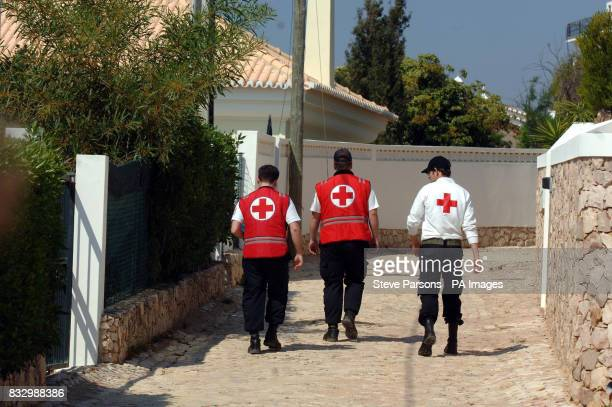 Volunteers from the local Red Cross search Luz in the Algarve Portugal after 3yearold Madeleine McCann went missing on Thursday evening