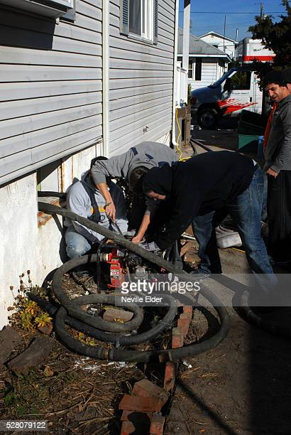 Volunteers from the 'Pour House' pub in Bay Ridge Brooklyn distribute supplies to those left without power and without heat in the aftermath of...