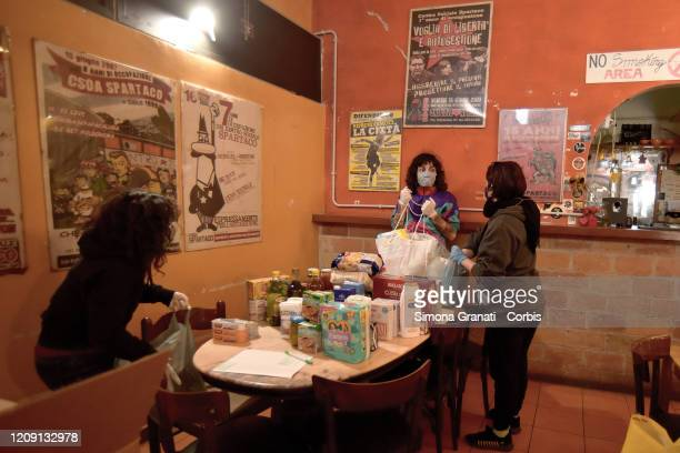 Volunteers from the Spartaco Social Centre and the Cinecittà Bene Comune network collect basic necessities and food to distribute to people in...