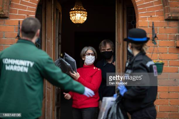 Volunteers from various emergency services and council members go door-to-door to distribute Covid-19 tests to resident's homes on February 03, 2021...