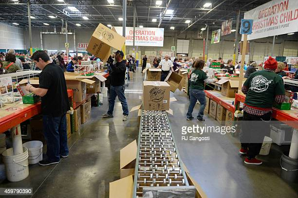 Volunteers gather in Aurora to pack shoeboxes full of Christmas gifts for children December 01 2014 Operation Christmas Child will send 10 million...