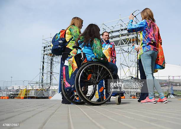 Volunteers gather together at the Olympic Park on March 4, 2014 ahead of the Sochi 2014 Winter Paralympics in Sochi, Russia.