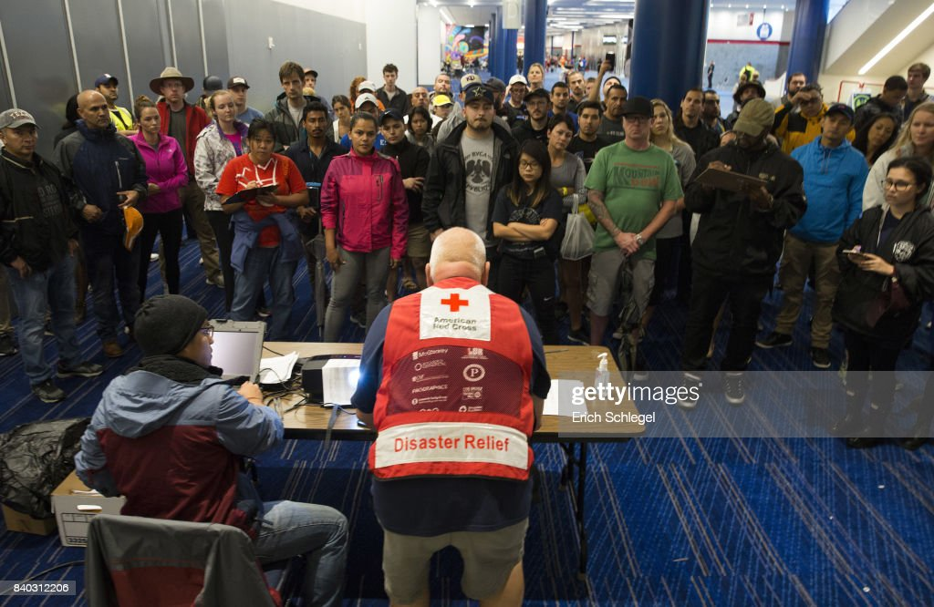 Volunteers get a briefing at the George Brown Convention Center that has been turned into a shelter run by the American Red Cross to house victims of the high water from Hurricane Harvey on August 28, 2017 in Houston, Texas. Harvey, which made landfall north of Corpus Christi late Friday evening, is expected to dump upwards to 40 inches of rain in areas of Texas over the next couple of days.