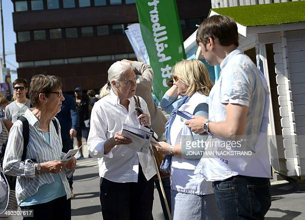 Volunteers give out electoral leaflets to people advertising different political Parties for the upcoming European Elections in Stockholm on May 25...