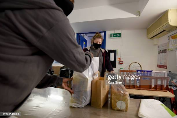 """Volunteers give out food parcels ahead of Christmas on December 10, 2020 in London, England. """"A Plate For London"""" is to raise funds for vulnerable..."""