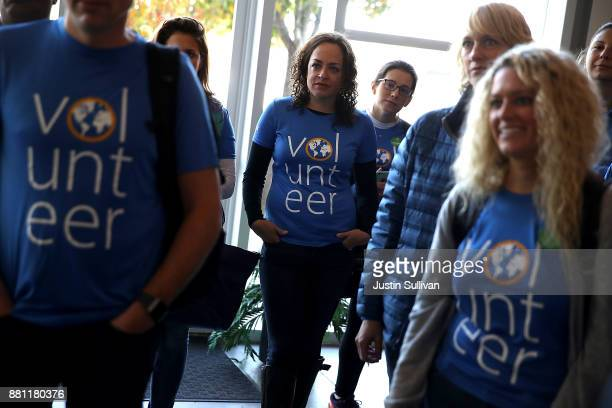 Volunteers go through an orientation before working at the SFMarin Food Bank on November 28 2017 in San Francisco California A day after consumers...