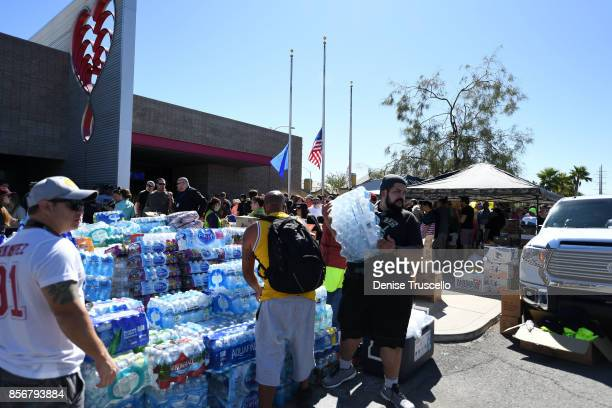 Volunteers hand out food and water to people waiting in line at United Blood Services to donate blood for the victims of the Route 91 Harvest country...
