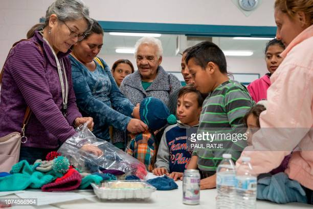 Volunteers hand out knitted hats for Central American migrant families at the Immaculate Heart of Mary Catholic Church in Las Cruces New Mexico on...