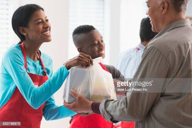 Volunteers handing out food at food drive