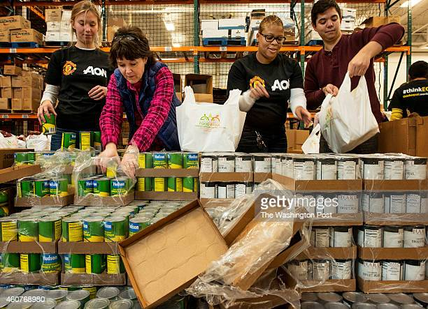 Volunteers Heidi Trott Wendy Hatch Stephanie Anderson and Peyton Pabst fill bags with food for seniors at the Capitol Area Food Bank in Washington DC...