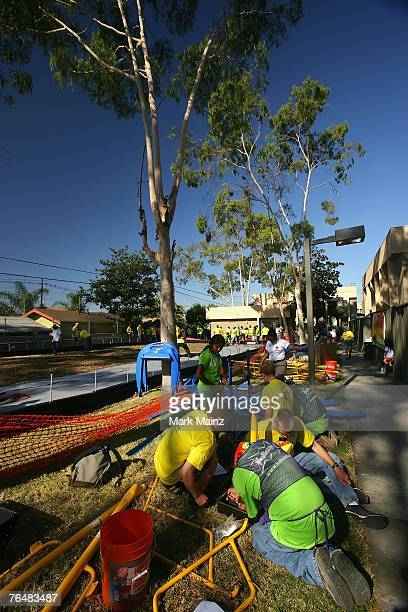 Volunteers help build a playground for underprivileged kids August 29 2007 in South Los Angeles California