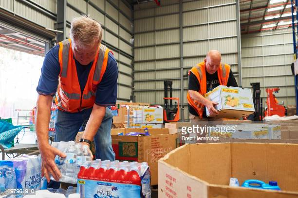 Volunteers help help organise large donations of goods at the Food Bank Distribution Centre bound for areas impacted by bushfires on January 07, 2020...