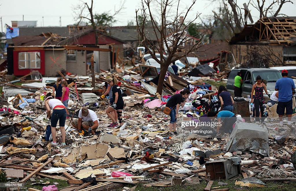 Volunteers help homeowners dig through a tornado ravaged neighborhood on May 25, 2013 in Moore, Oklahoma. The tornado of EF5 strength and two miles wide touched down May 20 killing at least 24 people and leaving behind extensive damage to homes and businesses. U.S. President Barack Obama promised federal aid to supplement state and local recovery efforts.