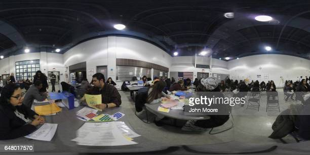 Volunteers help immigrants to complete their U.S. Citizenship applications at a CUNY Citizenship Now! event held in the Bronx on March 4, 2017 in New...
