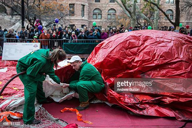 Volunteers help inflate the floats used in the Macy's Thanksgiving Day Parade on November 25 2015 in New York City The 89th Annual Macy's...