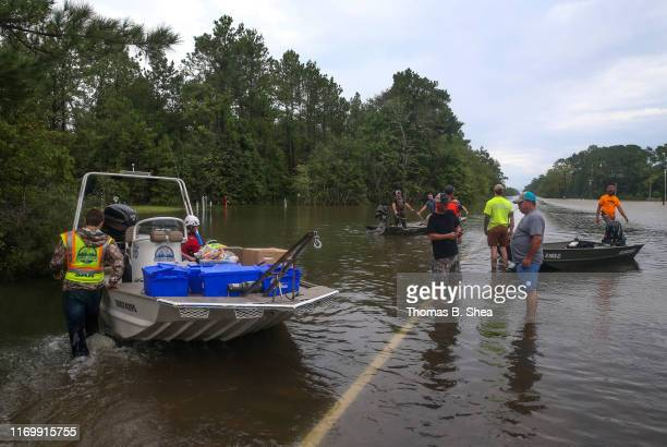 Volunteers help navigate other boats through the flooded waters on highway 124 on September 20 2019 in Beaumont Texas Gov Greg Abbott has declared...