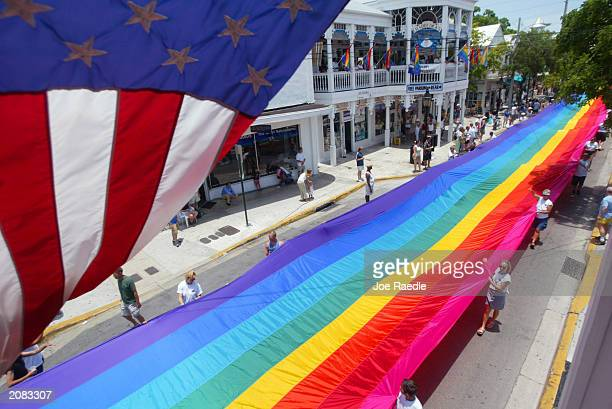 "Volunteers help stretch the mile and quarter long ""World's longest Rainbow Flag"" June 15, 2003 from the Gulf of Mexico to the Atlantic coast along..."