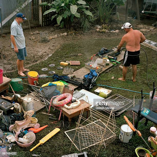 Volunteers help to clean mud off a variety of personal possessions on the backyard of one of the flooded houses in the Queensland town of Ipswich He...
