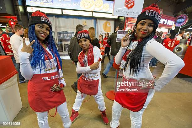 Volunteers help to raise money for the Salvation Army before an NHL game between the Detroit Red Wings and the Buffalo Sabres at Joe Louis Arena on...