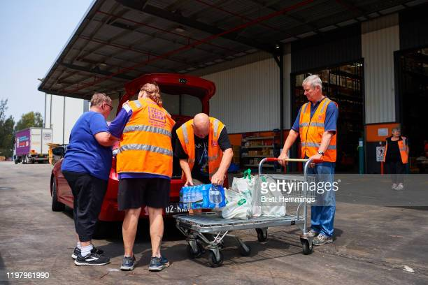 Volunteers help unload donated goods from the public at the Food Bank Distribution Centre bound for areas impacted by bushfires on January 07, 2020...