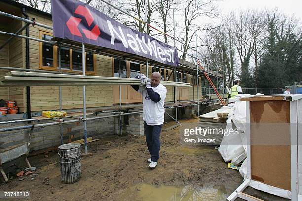 Volunteers help with the building of the new Clubhouse at Shepperton Cricket Club during the NatWest CricketForce 2007 day at Shepperton Cricket Club...