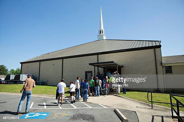 Volunteers helping to clean up line up to sign in at Beryl Baptist Church after a tornado yesterday tore through the area for the second time in...