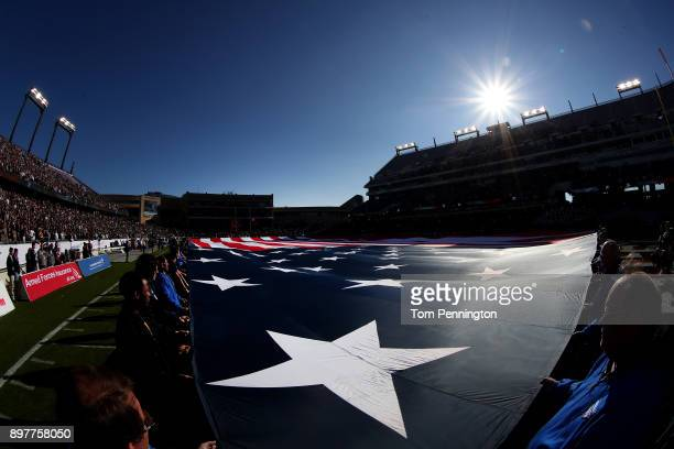 Volunteers hold an American flag during the National Anthem before Army Black Knights takes on the San Diego State Aztecs in the Lockheed Martin...