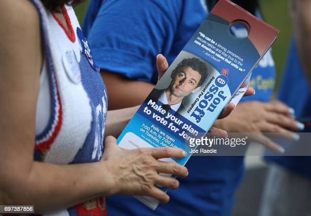 Volunteers hold campaign door hangers for Democratic candidate Jon Ossoff as they get out the vote for him in his run for Georgia's 6th Congressional...