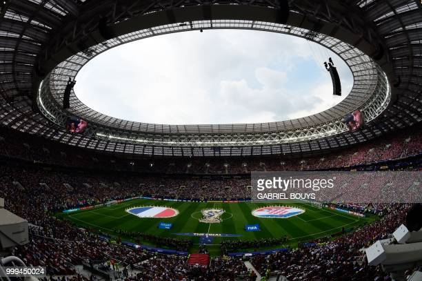 Volunteers hold Croatia's national flag and France's national flag prior to the Russia 2018 World Cup final football match between France and Croatia...