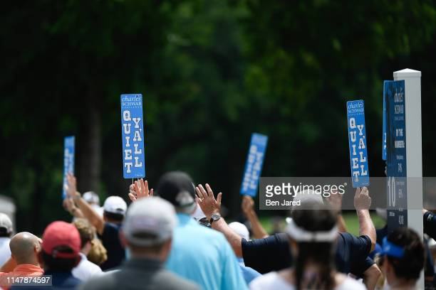 Volunteers hold quiet fans during the final round of the Charles Schwab Challenge at Colonial Country Club on May 26 2019 in Fort Worth Texas